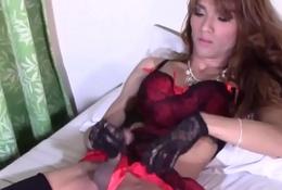 Glamcore ladyboy masturbating far downwards